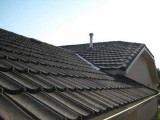 Steel shingles covered with stone granules