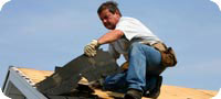 Roofing contractor working